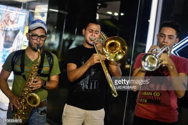Venezuelan migrants Jose Rivas Eduardo Pinto 21 and Gustavo Sequera members of musical orchestra Son de al lado play music for a living in the...