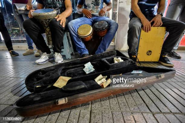 TOPSHOT Venezuelan migrants play music for a living in Cucuta Colombia border with Venezuela on February 20 2019
