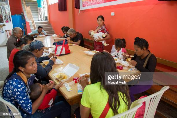 Venezuelan migrants receive a plate of food from the church of Tumbes on October 10 2018 in Tumbes Peru The Peruvian government have implemented the...