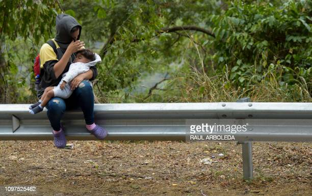 TOPSHOT Venezuelan migrants rest as they walk on the road from Cucuta to Pamplona in Norte de Santander Department Colombia on February 10 2019...