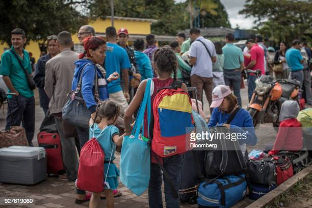 Venezuelan migrants stand outside the Federal Police building in Boa Vista, Roraima state, Brazil, on Thursday, Feb. 15, 2018. Hundreds of thousands...