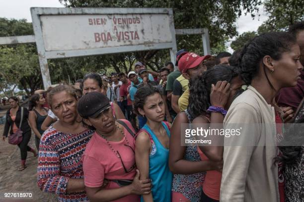 Venezuelan migrants wait in line to receive food donations at Simon Bolivar Square in Boa Vista Roraima state Brazil on Saturday Feb 17 2018 Hundreds...