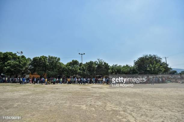 Venezuelan migrants wait in line to receive food outside La Divina Pastora shelter in Villa del Rosario Colombia in the border with Venezuela on...