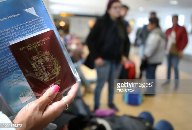 Venezuelan migrants wait to enter the boarding area of the international airport in Lima after a group of Venezuelan nationals who chose to return to...