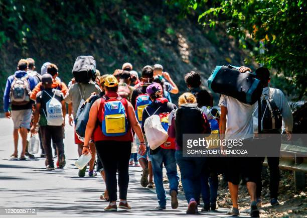 Venezuelan migrants walk along a highway in Cucuta, Colombia, on the border with Venezuela, on February 2 amid the COVID-19 pandemic.