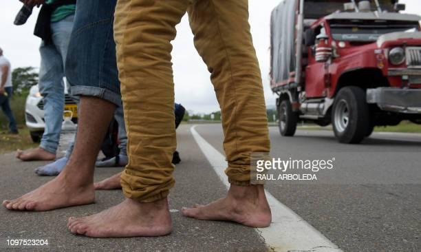 TOPSHOT Venezuelan migrants walk on the road from Cucuta to Pamplona in Norte de Santander Department Colombia on February 10 2019 Opposition leader...
