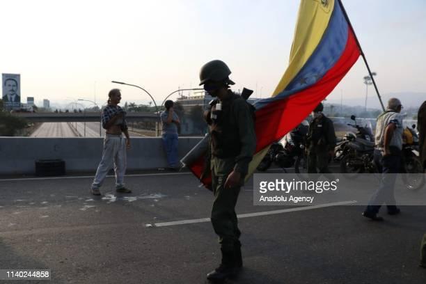 Venezuelan military member is seen near the Generalisimo Francisco de Miranda Airbase La Carlota in Caracas Venezuela April 30 2019