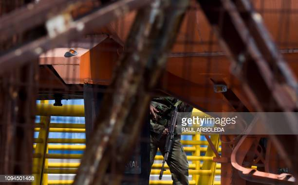 A Venezuelan military officer stands guard as containers block the Tienditas Bridge which links Tachira Venezuela and Cucuta Colombia on February 6...