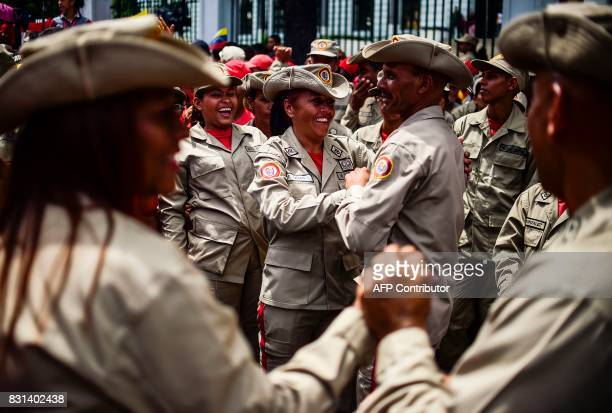 TOPSHOT Venezuelan militias demonstrate their support to the government of Venezuelan President Nicolas Maduro and against US President Donald Trump...