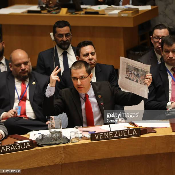 Venezuelan Minister of Foreign Affairs Jorge Alberto Arreaza addresses the United Nations Security Council while holding up a newspaper in a meeting...