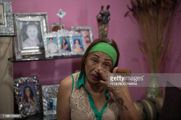 Venezuelan Minu Vasquez who takes care of her grandchildren after their parents emigrated cries as she speaks during an interview with AFP at Petare...