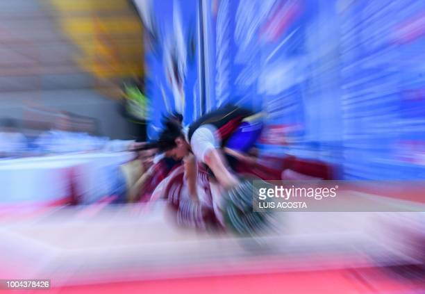 Venezuelan Mirufai Murillo takes part in the Women's Weightlifting 90 Kg clean and jerk competition, during the 2018 Central American and Caribbean...