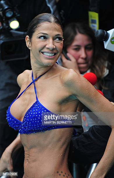 Venezuelan model and actress Catherine Fulop poses for photographers in a pool during the Viña del Mar International Song Festival on February 27...