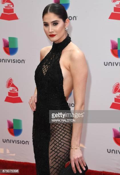 Venezuelan model Mariam Habach arrives for the 18th Annual Latin Grammy Awards in Las Vegas Nevada on November 16 2017 / AFP PHOTO / Mark RALSTON