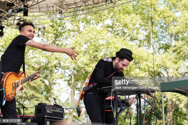 Venezuelan musicans Henry D'Arthenay on guitar and Eduardo Cabra on keyboards both of the Rock group La Vida Boheme perform onstage at the closing...