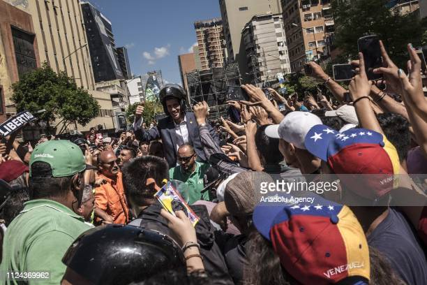 Venezuelan National Assembly's President Juan Guaido who has appointed himself interim president greets the crowd as opponents gather to stage a...