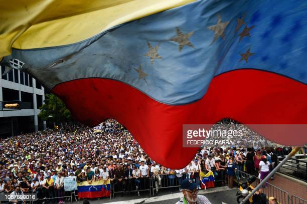 A Venezuelan national flag flutters during a mass opposition rally against President Nicolas Maduro in which Venezuela's National Assembly head Juan...