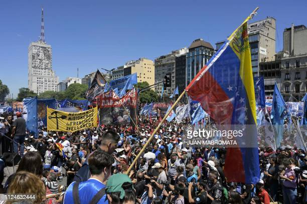 A Venezuelan national flag is seen as thousands of demonstrators gather along 9 de Julio avenue in Buenos Aires where social organizations called for...