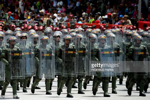 Venezuelan National Guard personnel in riot gear take part in a military parade to celebrate the 207th anniversary of the Venezuelan Independence in...