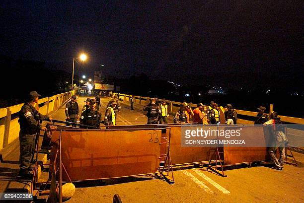 TOPSHOT Venezuelan National Guard personnel stand guard behind a barrier on the Simon Bolivar bridge on the Colombian border with Venezuela on...