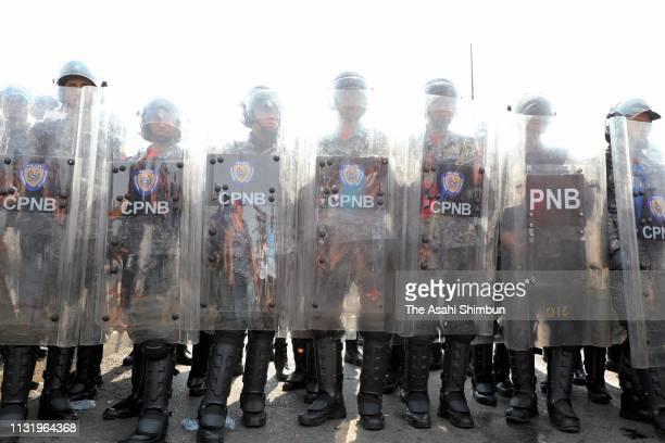 Venezuelan National Guard soldiers close at the Simon Bolivar international bridge on February 23 2019 in Cucuta Colombia