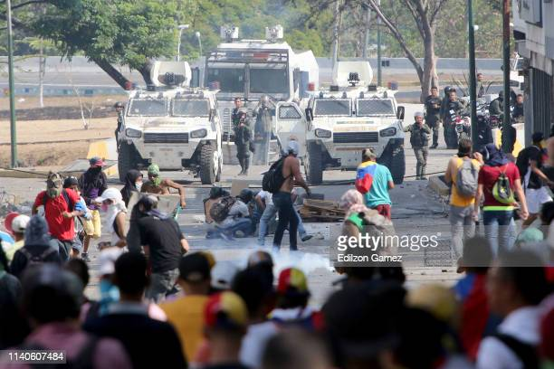 Venezuelan National Guard throw tear gas to ProJuan Guaidó demonstrators after the May 1 demonstration at Plaza Altamira on May 1 2019 in Caracas...