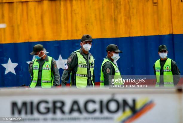 Venezuelan national guards use face masks as a preventive measure against the spread of the new coronavirus COVID19 at the Simon Bolivar...
