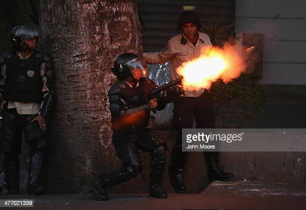 Venezuelan national police fire tear gas at antigovernment protesters on March 6 2014 in Caracas Venezuela Three weeks of protests against the...