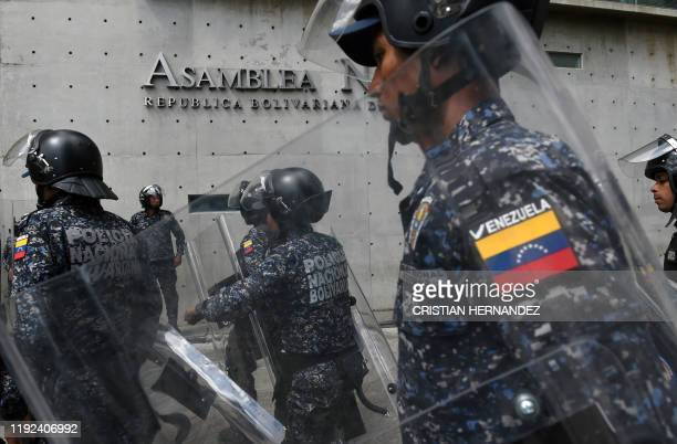 Venezuelan National Police members stand guard outside the National Assembly on January 7, 2020 in Caracas. - Opposition leader Juan Guaido and a...