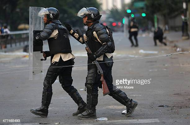 Venezuelan national policemen advance on antigovernment demonstrators on March 6 2014 in Caracas Venezuela Protesters continued to stage...