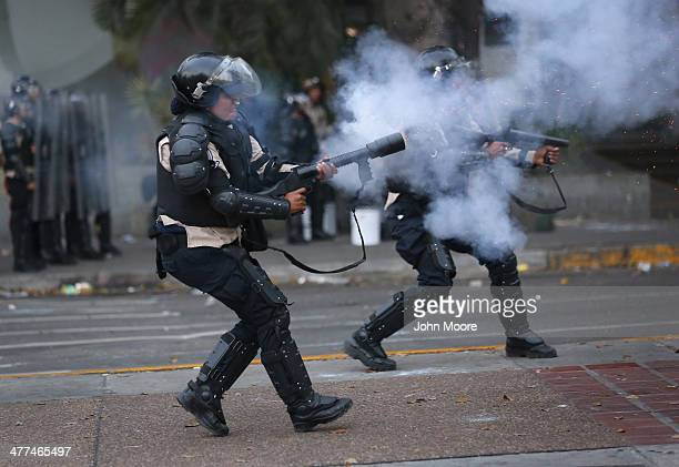 Venezuelan national policemen fire teargas at antigovernment demonstrators on March 6 2014 in Caracas Venezuela Protesters continued to stage...