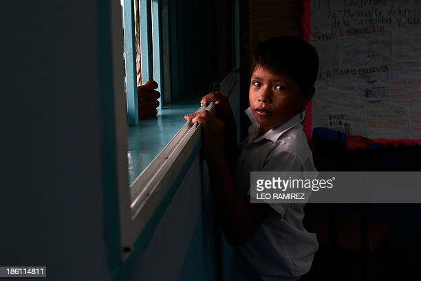 A Venezuelan native boy is pictured at the Esperanza multiethnical school in Puerto Ayacucho in the Venezuelan state of Amazonas on October 24 2013...