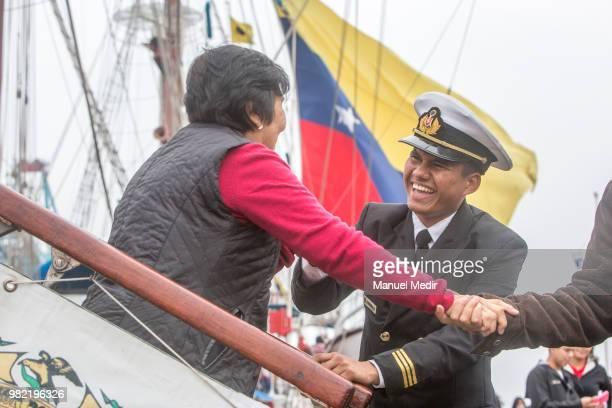 Venezuelan officer of the Simon Bolivar helps a woman come down the ship during the Velas Latinoamerica 2018 Nautical Festival at Callao Naval Base...