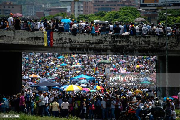 TOPSHOT Venezuelan opposition activists carry out a protest against the government of President Nicolas Maduro in Caracas on May 15 2017 Venezuelans...
