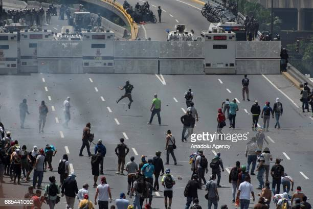 Venezuelan opposition activists clashes wiht Police in Caracas on April 6 2017 The centerright opposition vowed fresh street protests after earlier...