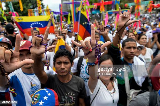 TOPSHOT Venezuelan opposition activists rally to protest against the government of President Nicolas Maduro at Francisco de Miranda Avenue in Caracas...