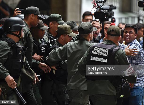 Venezuelan opposition congress members confront National Guard members in front of the National Electoral Council in Caracas on April 21 2016 2016 A...