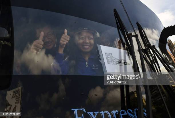 Venezuelan opposition deputies wave while traveling in a caravan of buses heading to the border with Colombia to bring in USsupplied humanitarian aid...
