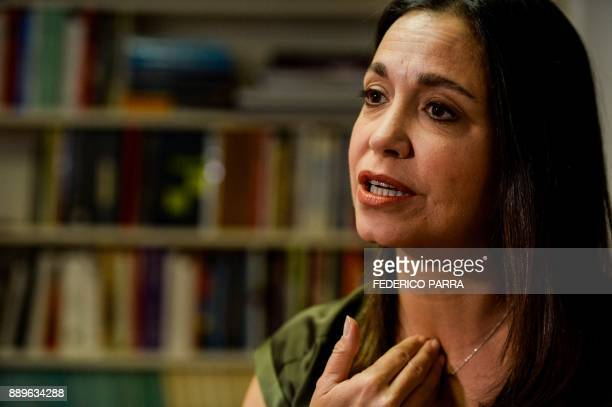Venezuelan opposition excongresswoman Maria Corina Machado gestures as she speaks during an interview with AFP in Caracas on November 23 2017...