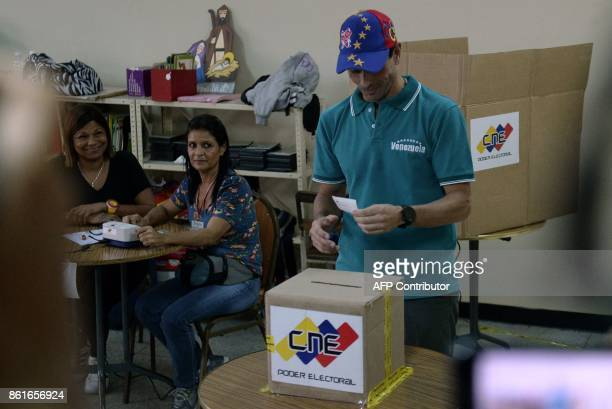 Venezuelan opposition figure and outgoing governor of Miranda Henrique Capriles casts his vote at a polling station in Caracas' municipality of...