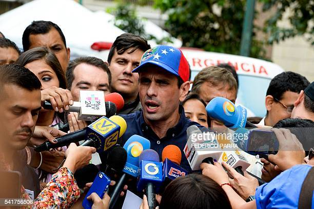 Venezuelan opposition leader and Miranda State governor Henrique Capriles talks with the press during the authentication before the National...