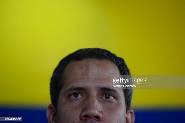 Venezuelan opposition leader and National Assembly Leader Juan Guaido looks on during a press conference with international media at Centro Plaza on...