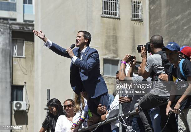 TOPSHOT Venezuelan opposition leader and self declared acting president Juan Guaido speaks during a rally to press the military to let in US...