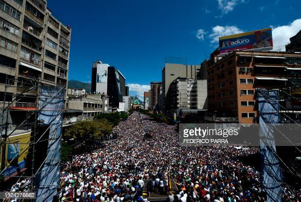 Venezuelan opposition leader and self declared acting president Juan Guaido speaks to supporters during a rally to press the military to let in US...