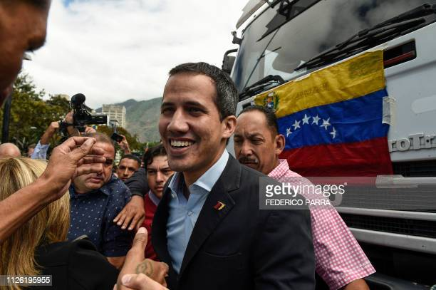 Venezuelan opposition leader and self declared acting president Juan Guaido arrives to take part in a demonstration called by the transportation...