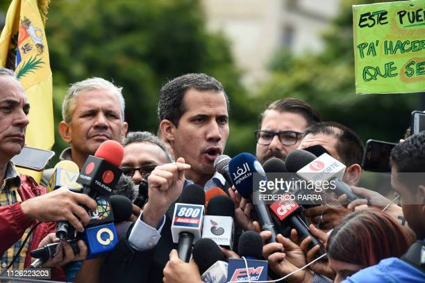 Venezuelan opposition leader and self declared acting president Juan Guaido delivers a speech during a demonstration called by the transportation...