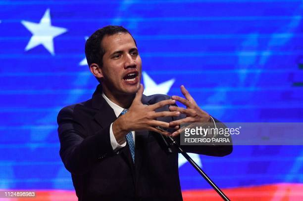 Venezuelan opposition leader and selfdeclared acting president Juan Guaido speaks during a meeting with workers and union leaders in Caracas on...