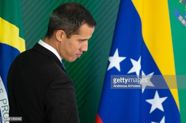 Venezuelan opposition leader and self-declared iterim president Juan Guaido looks on after a meeting with Brazilian President Jair Bolsonaro at...