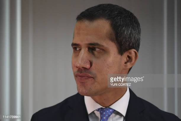 Venezuelan opposition leader and self-declared president Juan Guaido offers an interview to AFP in Caracas on May 6, 2019. - 'We're very close to...