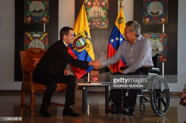 TOPSHOT Venezuelan opposition leader and selfproclaimed acting president Juan Guaido and Ecuadorean President Lenin Moreno shake hands during a...